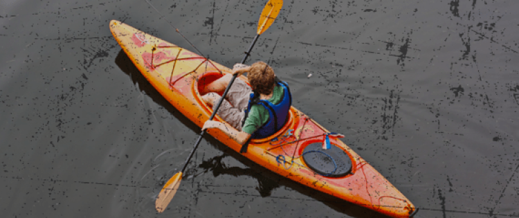 young man kayaking on a river