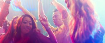 Photo of people dancing in a nightclub.