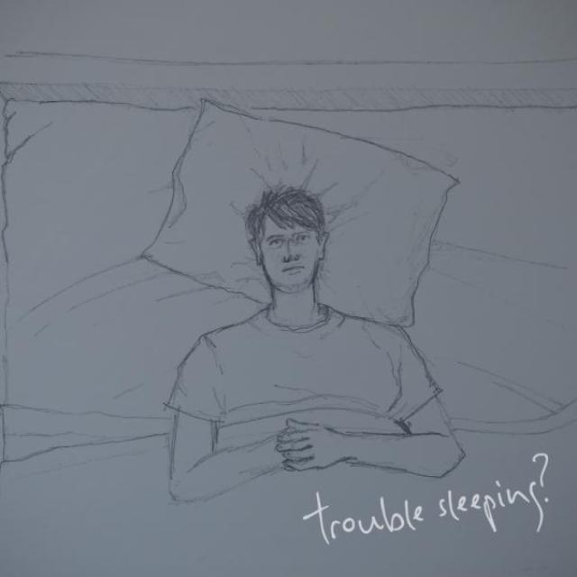 "A hand drawn sketch of a man lying awake in bed with the text ""trouble sleeping?"" overlaid in cursive."