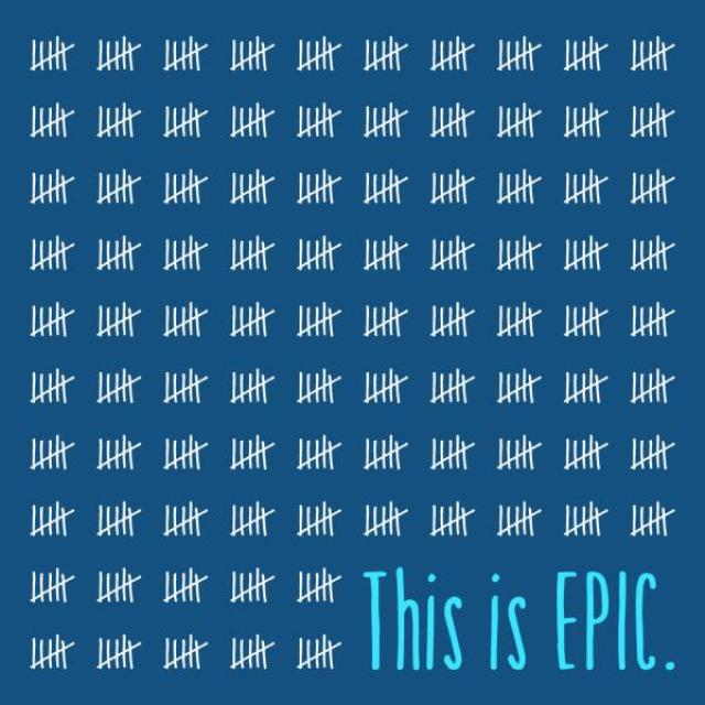 "A blue background, covered in tally marks in groups of five, with the words ""This is Epic."" in the bottom right corner."