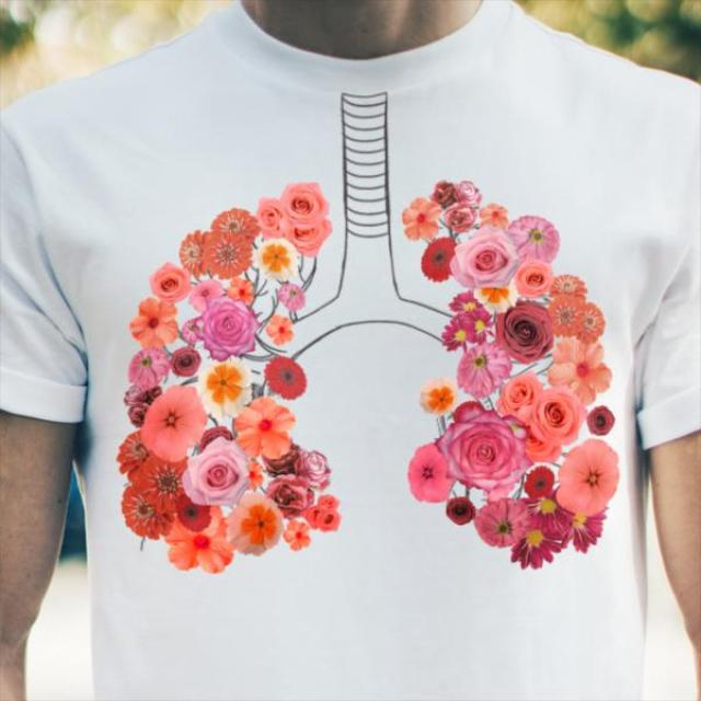 An image of a person wearing a t-shit with and image of lungs made of flowers