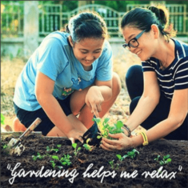 "Photo of woman and teenage daughter happily planting seedlings in a garden. Text says ""gardening helps me relax"""