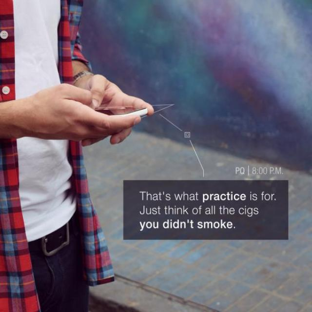 "A close up of a person texting on their phone, with the message, ""That's what practice is for. Just think of all the cigs you didn't smoke."""