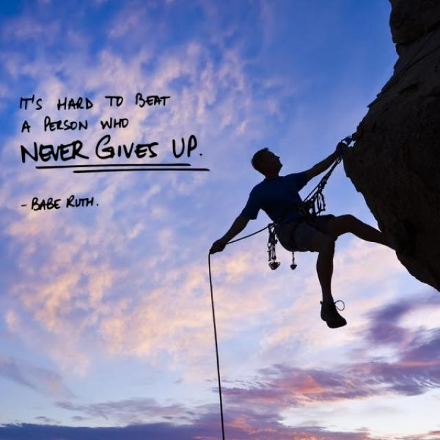 "Image of the silhouette of a rock climber climbing a rock face with sky and clouds behind them.  Caption reads, ""Its hard to beat a person who never gives up! -Babe Ruth"""