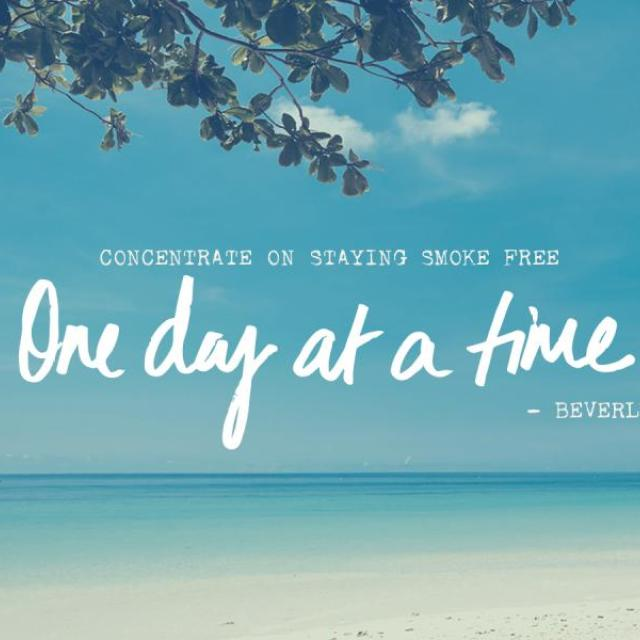 "A peaceful beach scene with an overhanging tree branch and the quote, ""Concentrate on staying Smokefree one day at a time.- Beverly"" """