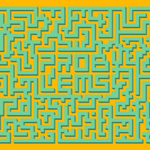 "Green and orange maze. Center walls spell out the word ""problems"""