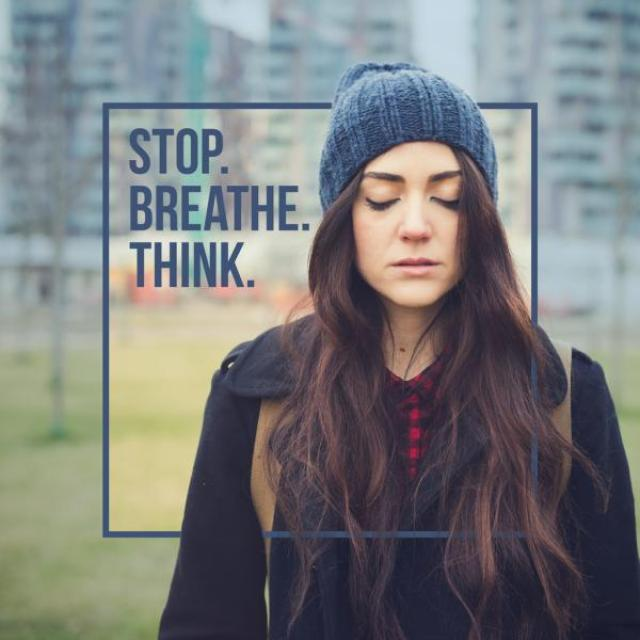 "A woman in a knit hat with her eyes closed, with the caption, ""Stop. Breathe. Think."""