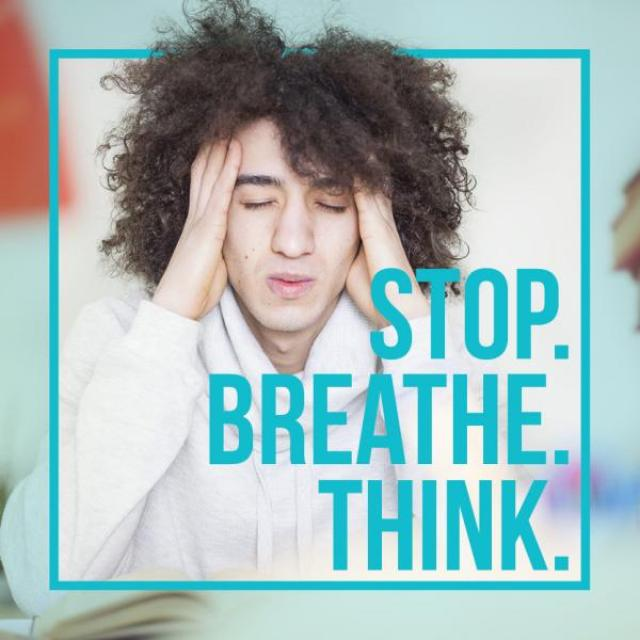 "Photo of young man with eyes closed and hands at temples, looking stressed with pile of books in background. Text says: ""Stop. Breathe. Think."""