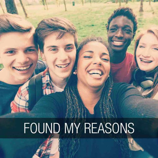 "Group of five teens crowd in to take a selfie. The text ""found my reasons"" runs along the bottom of the image in a banner."