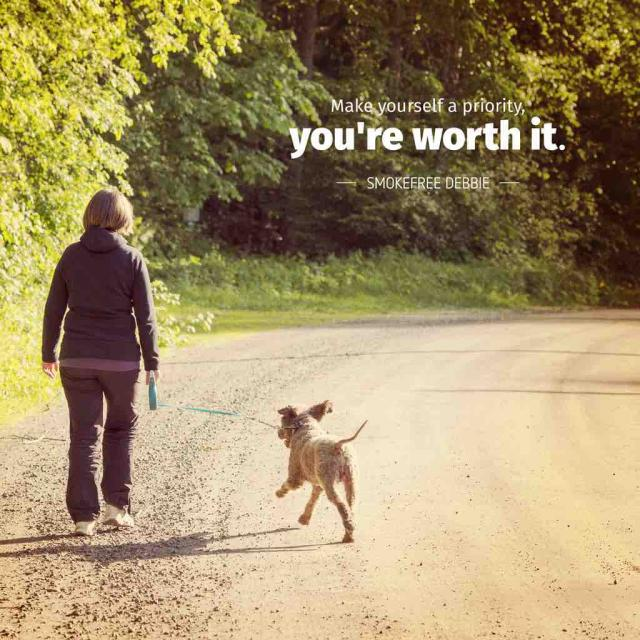 "Photo of a middle aged woman walking her dog with text saying ""Make yourself a priority, you're worth it -Smokefree Debbie"""